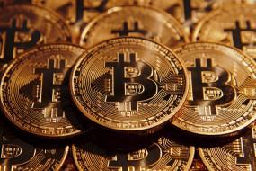 Ринок криптовалют падає: біткоїн опустився нижче 6 тисяч доларів